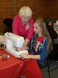Senior Moments Elder Teaching Sewing